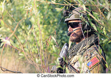 close up of American Soldier in the bushes