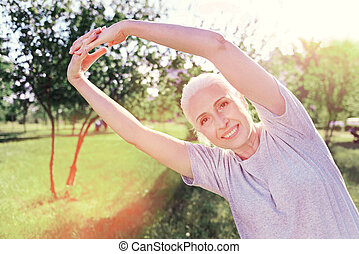Close up of amused woman doing exercises