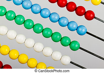 Close-up of an abacus on a grey background