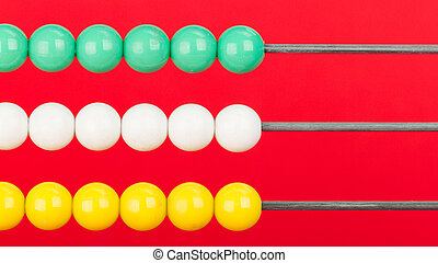 Close-up of an abacus on a red background