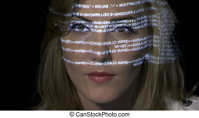 Close up of an ai artificial intelligence IT female programming binary code on futuristic holographic display reflected on her face