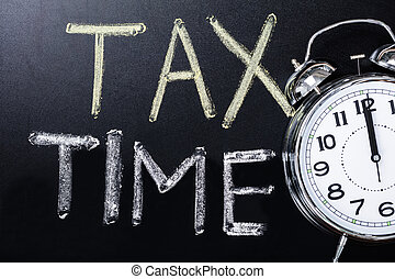 Close-up Of An Alarm Clock Near Tax Time Concept On...