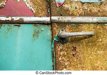 Close up of an antique old rusted blue car door