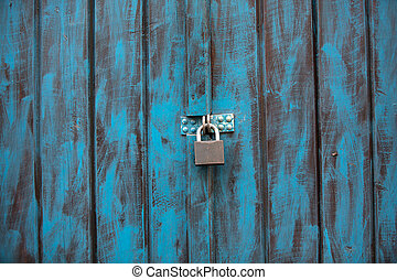 Close up of an antique wooden door painted in blue