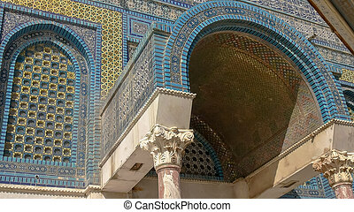 close up of an arched entrance to dome of the rock mosque in jerusalem
