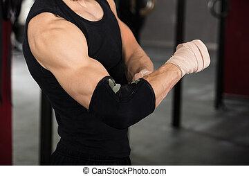 Athlete Person Wearing Bandage On Elbow