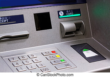 ATM - Close up of an ATM machine. Keyboard and insert card