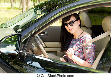 Close up of an attractive brunette woman in a car