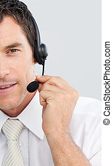 Close-up of an attractive businessman working in a call center