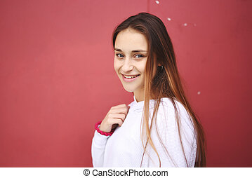 Close up of an attractive young woman.