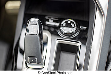 close-up of an automatic transmission knob in a new modern car. top view