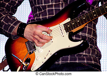 Close up of an electric guitar being played