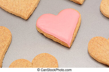 Close-up of an iced heart-shaped biscuit for Valentine's Day
