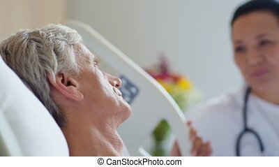 Close up of an illl senior man lying in a hospital bed -...