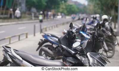 Close up of an Indonesian stop place for bikes. Indonesian...