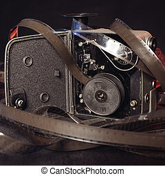 close-up of an old film and the insides of a vintage movie camera on the table