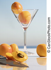 an open apricot next to a knife