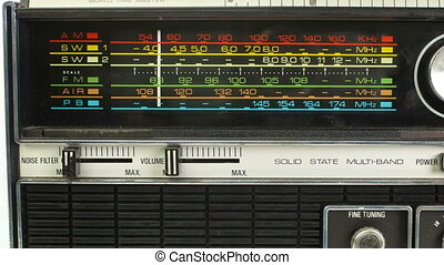 close up of an retro radio with the marker running through the different stations and frequencies