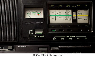 close up of an retro radio with the marker running through...