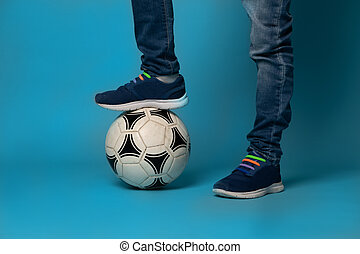 Close-up of an unrecognizable boy standing on a soccer ball