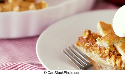 close up of apple pie with ice cream on plate - food,...