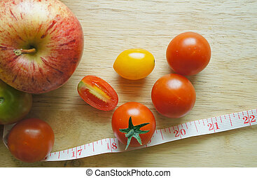close up of Apple tomatoes on table (diet concept)