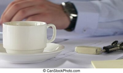 close up of architect drinking coffee - architecture,...