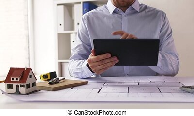 close up of architect with tablet pc and blueprint