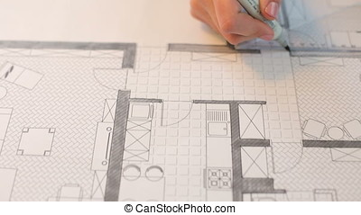 Close up of architect woman working on a new project at her desk