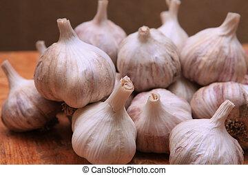 aromatic garlic small group - close up of aromatic garlic...