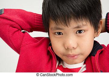 Close up of asian cute boy looking at camera
