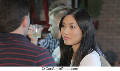 Close up of asian girl drinks wine at the bar