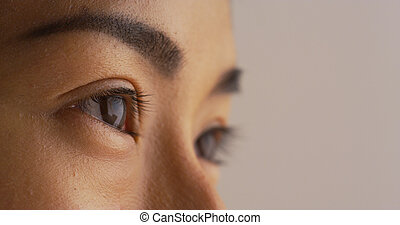 Close up of Asian woman looking away