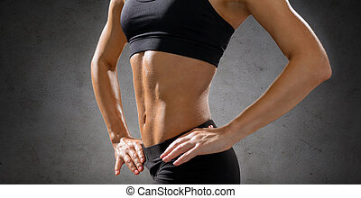 close up of athletic female abs in sportswear - fitness, ...