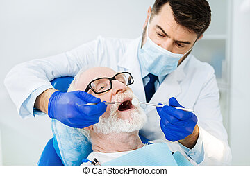 Close up of attentive stomatologist in the dental office