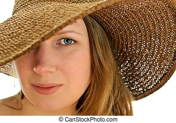 Close-up of attractive woman in hat, isolated on white