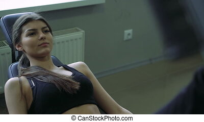 Close up of attractive young woman focused on her leg press exercises. 4k