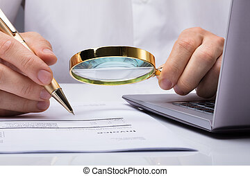 Auditor Inspecting Financial Documents - Close-up Of Auditor...