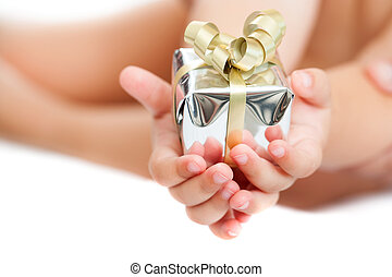 Close up of babies hands holding present.