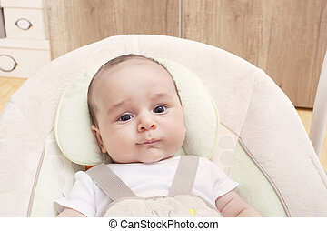 Close-up of Baby in his swing