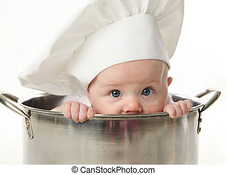 Close up of baby sitting in stock pot - Close up portrait of...