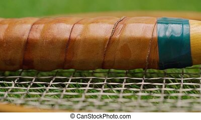 Close up of badminton rackets lying on grass. High quality FullHD footage