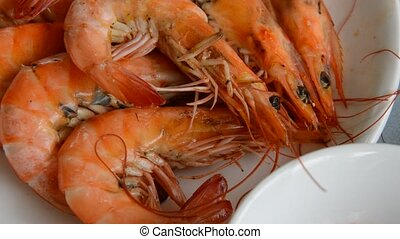 close up of baked salt prawn dipping spicy and sour sauce...