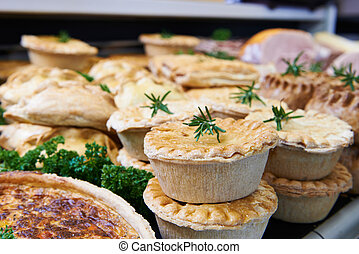 Close Up Of Baked Savoury Goods In Delicatessen