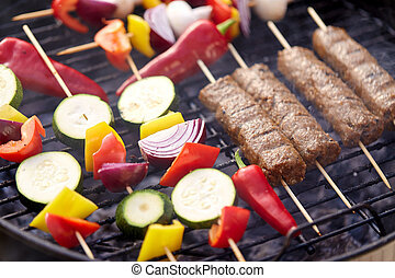 close up of barbecue kebab meat roasting on grill