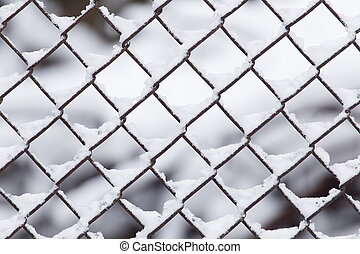 Close-up of barbwire covered by snow
