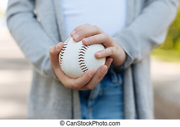 Close up of baseball ball that being in hands