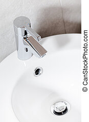 Close up of basin with mixer faucet - Close up of clean...