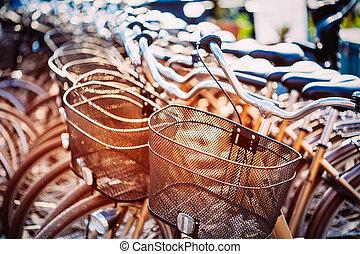 Close Up Of Basket Of Bicycle On Parking. Sunlight Sunshine Thro