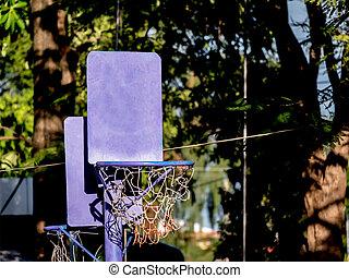 close up of basketball hoop for little children, in the garden